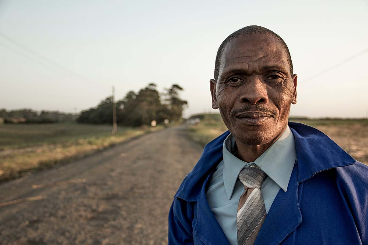 African Man At Field